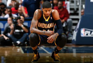 Paul George kneels