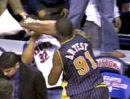 Artest throws punch