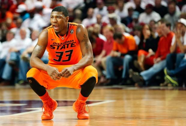 Marcus Smart kneels
