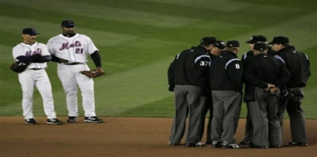 umps gather for instant replay