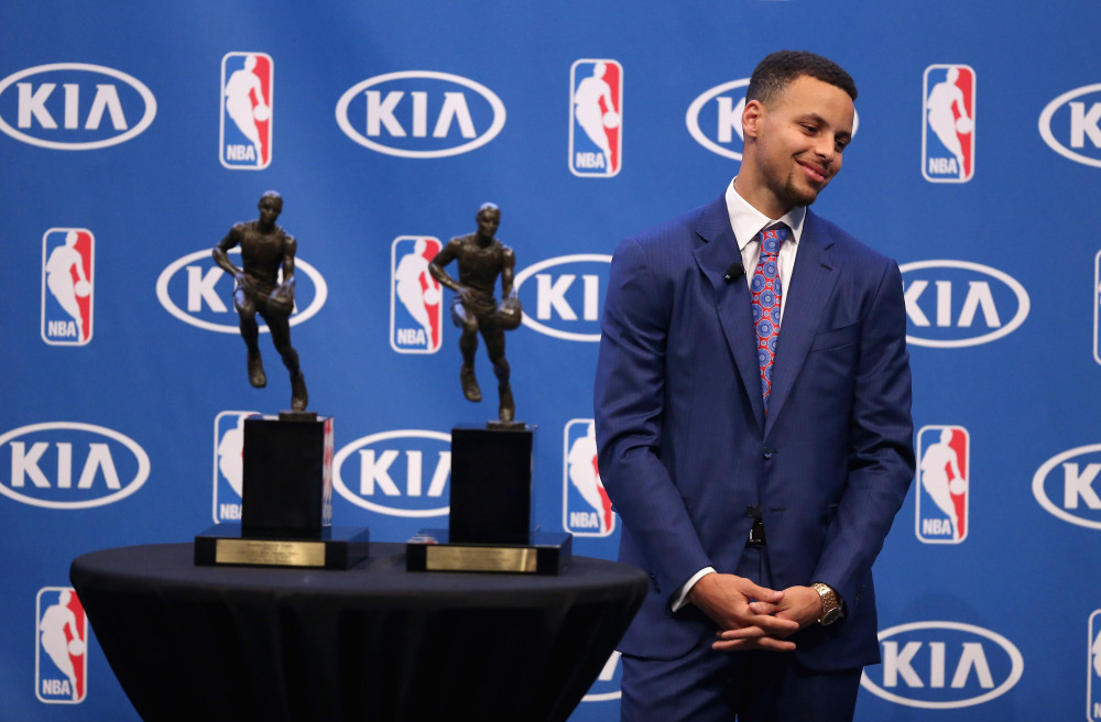 OAKLAND, CA - MAY 10: Stephen Curry of the Golden State Warriors stands next to his back-to-back NBA Most Valuable Player Awards during a press conference at ORACLE Arena on May 10, 2016 in Oakland, California. NOTE TO USER: User expressly acknowledges and agrees that, by downloading and or using this photograph, User is consenting to the terms and conditions of the Getty Images License Agreement. (Photo by Ezra Shaw/Getty Images) ORG XMIT: 638972705 ORIG FILE ID: 530278240