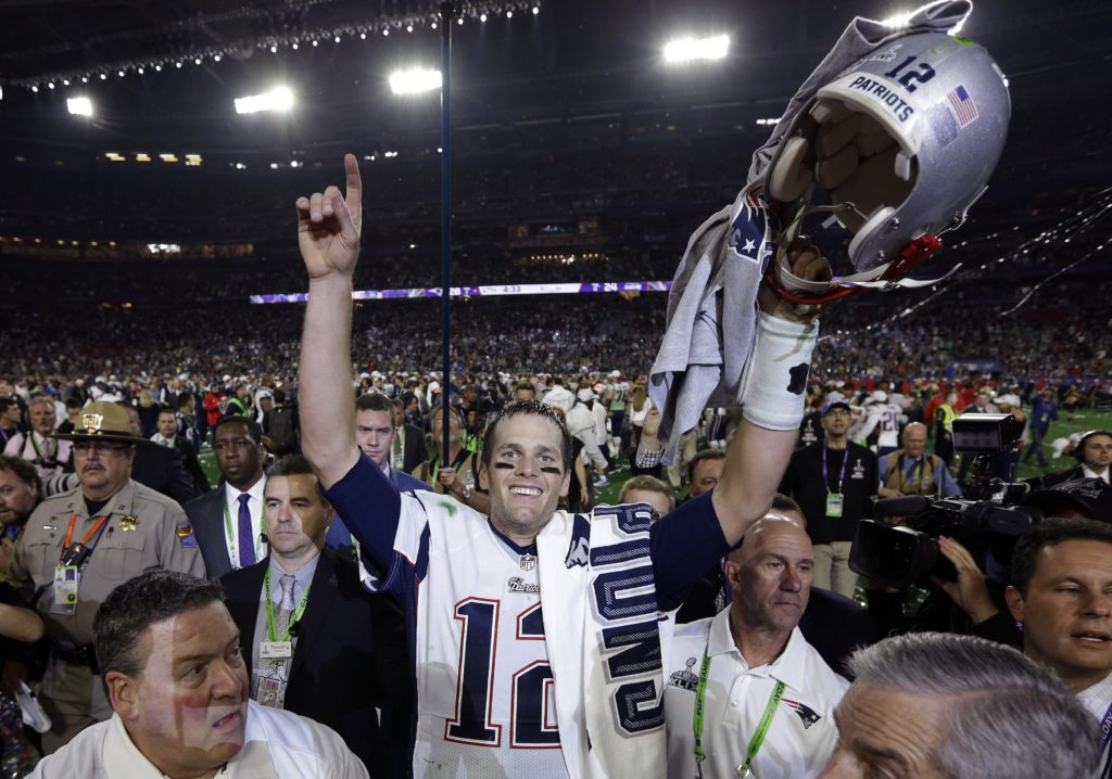 New England Patriots quarterback Tom Brady (12) celebrates after the NFL Super Bowl XLIX football game against the Seattle Seahawks Sunday, Feb. 1, 2015, in Glendale, Ariz. The Patriots won 28-24. (AP Photo/David J. Phillip)