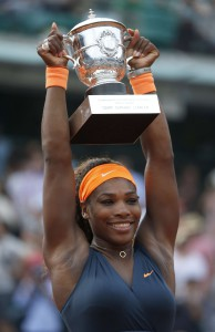 USA's Serena Williams holds up the Suzan