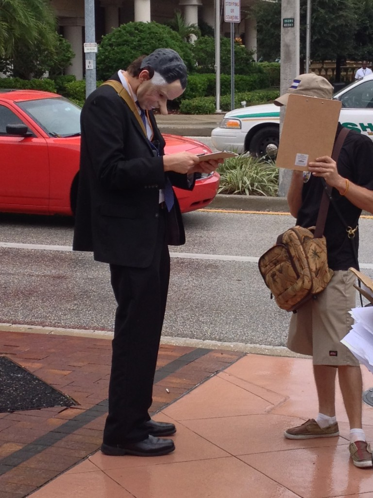 3 - Smell the irony as outside Comic Con Tricky Dick signs a petition t legalize marijuana