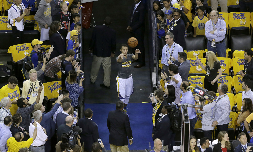 Golden State Warriors guard Stephen Curry shoots from an aisle while warming up before Game 1 of the NBA basketball Western Conference finals between the Warriors and the Oklahoma City Thunder in Oakland, Calif., Monday, May 16, 2016. (AP Photo/Jeff Chiu) ORG XMIT: OAS101